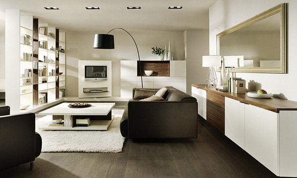 ein offenes sehr schon eingerichtetes wohnzimmer mit designermobeln